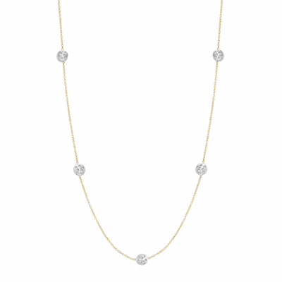 This delicate 18 karat gold station necklace features five tiny circular cutout coins, and a matte finish contrasted by white diamonds. The charms are slightly hollow allowing for the circular openings and the diamonds to really shine with each and every turn!    Available in 18 karat gold variations. Features twenty burnish-set diamonds, approx. .35 carat. 17'' 18 karat gold chain. Matte finish. 0.8cm diameter, approx. 2g Please inquire at sales@danabronfman.com for different lengths and color variations.  Made in New York City from the world's finest materials with ethically-sourced diamonds. Please allow 3-4 weeks for delivery as each piece is created specially for you.