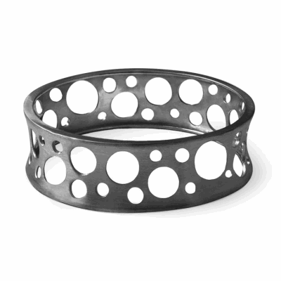 "Wide convex-shaped cuff with circular cutouts of varying sizes.  Available in sterling silver or black rhodium-plated sterling silver. Matte finish. Available in diameters, 2.4 or 2.7"" 2.1 cm, 34 g Made in New York City from the world's finest materials. 2-5 of each variation in stock available to ship right away. Please allow 3-5 business day for your order to arrive!"