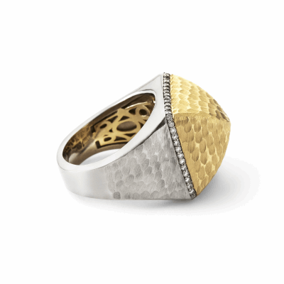 This oversized ring makes a statement that can be worn day or night with its dimension. The pyramidal top's hammered finish is nearly impossible to scratch and gives off a subtle shine, while a row of diamonds encircles its sides for just the right amount of sparkle.   Available in all 18 karat yellow gold, or two tone with 18 karat yellow and white gold. Both color ways feature an 18k yellow gold inner lining.  Diamonds approx. .33 tcw Ring weighs approx. 24 g. Pyramid measures 17mm x 17mm and is 11.3mm high. Made in New York City from the world's finest materials and ethically-sourced diamonds. Please allow 3-4 weeks for delivery as each piece is specially made for you.