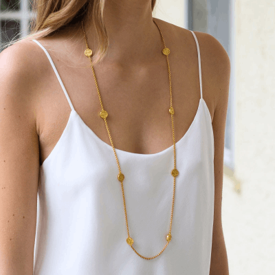 The Valencia Station Necklace is an elegant, 17th century-inspired chain embellished with 24k gold, mother of pearl, or imported glass coins. Learn more: