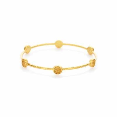 The Valencia Bangle is a gold stackable bangle inspired by 17th century Spanish coin, embellished with 24k gold stations. Learn more: