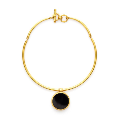 The Valencia Double Sided Choker features a royal 17th century-inspired, four-quadrant 24k gold crest opposite a shimmering pearl or glass gemstone. Learn more: