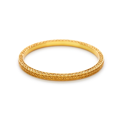 The Medici Bangle features 24k gold textured details with angled sides, giving it volume. Learn more: