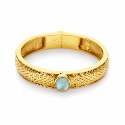 Hinged to fit all wrists, the Medigi Single Stone Hing Bangle features 24k gold detail and a single oval center stone of pearl or imported glass. Learn more: