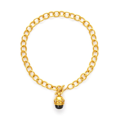 The Medici Statement Necklace features shimmering pearl cabochon, stone, or pearl capped with raised details, suspended from a 24k gold link. Learn more: