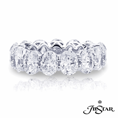 Dazzling diamond eterntiy band featuring 17 oval diamonds in a shared prong setting, handcrafted in platinum.