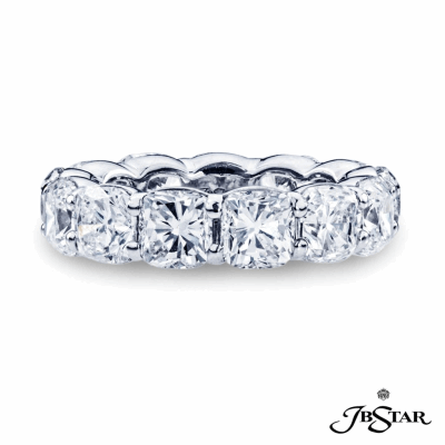 Dazzling diamond eternity band featuring 14 perfectly matched cushion cut diamonds in a shared prong setting. Handcrafted in platinum.