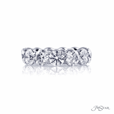Dazzling diamond eternity band featuring 13 beautifully matched round diamonds in a shared prong setting. Handcrafted in platinum. [details] Stone Information S