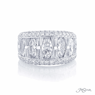 Dazzling diamond wedding band featuring marquise and tapered baguettes in a beautiful center channel designed surrounded by round diamonds pave.This ring is size 6, the price may differ if it's made in a smaller or larger ring size. Total diamond weight GVS2 5.14cts