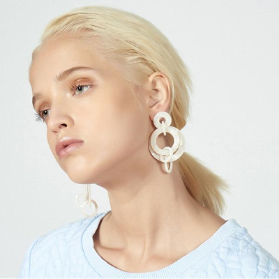 """The modern hoop earring. These intertwining flattened mother of pearl acetate rings dangle to form a 3"""" drop. Surgical steel post closure and extremely lightweight from day to night."""