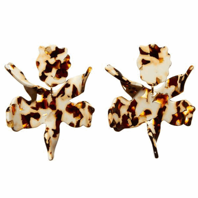 """Our best selling earring in a new color. 3"""" by 2 1/2"""" hand swirled tortoise acetate lily flower with 14k gold plated clip on backs. Lightweight and wearable day to night. Padded clip-on closure."""