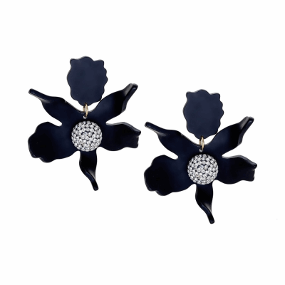 """Our best selling earring. 3"""" by 2 1/2"""" matte black acetate lily flower with a 3/4"""" czech pave crystal center. 14k gold plated clip on backs. Light weight and wearable day to night. Padded clip-on closure."""