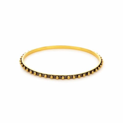 The Soho Bangle features 24k gold studded features, available in all gold or mixed metal. Learn more: