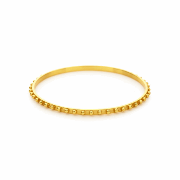 Closeup photo of SoHo Bangle with Gold finish in size Small