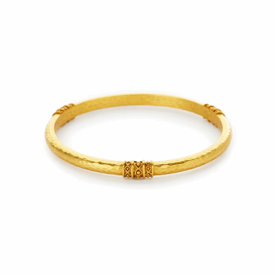 Our Catalina Bangle is a classic bangle with a glistening hammered finish, decorated with a bead-in-diamond motif and plated with 24k gold. Shop now: