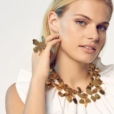 Made of connecting 14k gold plated lily-shaped components, this necklace is perfect for crew necks and bare necks. 16 inches long with a lobster clasp with a 3-