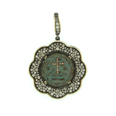 """Cynthia Ann is a Huston based designer and her collection """"Ancient & Old"""" consists of authentic vintage crosses & coins. She hand picks each piece and repurposes them into pendants. The original coins & crosses were made by hand, not machines, and were calling to be """"re-purposed"""" and """"re-loved"""". The history, brilliant craftsmanship and unique stones are what drew her to each precious piece. Each piece is lovingly and uniquely designed to enhance its original history and beauty making it one of a kind."""