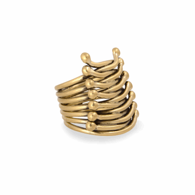 Our statement corset ring is inspired by the Dinka tribe's corset design from 1970's southern Sudan.  This 18K gold ring is hand woven and custom made to order so details may vary slightly.