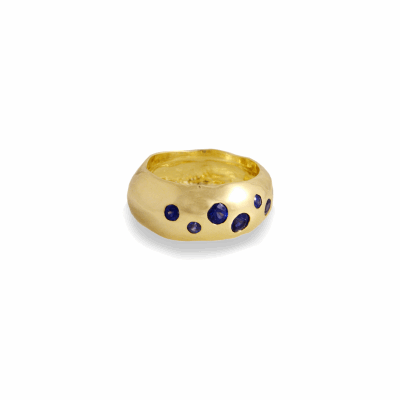 Our beloved 18K gold galaxy ring has a constellation of 7 sparkling stones set in a band with natural molten details around the edges. Cast from an ancient Ethiopian gypsy ring, we have left the organic state of the metal to shine through.