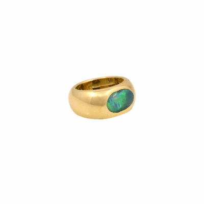 A vivid 2.24 carat Australian opal is set in this hefty 18K gold gypsy band. This is a special opal with intense fire and soul . The colors echo the heart of the ocean and sunlight on the the seas of Sardinia, the Caribbean and the shores of East Africa.