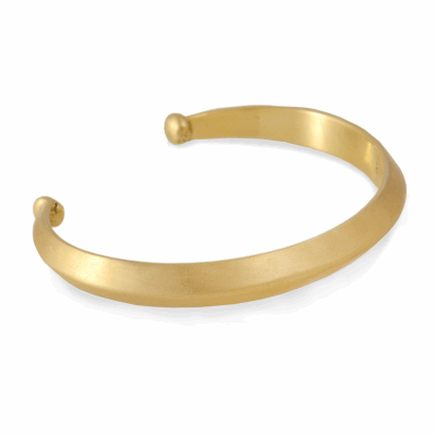 This classic cuff style hailing from the great Ethiopian city of Harar has been re-imagined in solid 18K gold with a beautiful matte finish.  This piece is hand made and one of a kind.