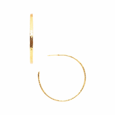 Modern boho gold hoop earring has a textured, hammered finish, giving it an artisan-like handmade feel, with more dimensions than a thin gold hoop.