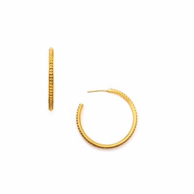 Our delicate beading gives classic gold hoops a touch of old-world sophistication. Shop this accessory staple now: