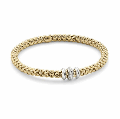 From the Fope Solo collection, stunning bracelet in 18k Yellow Gold with a 18k white gold & diamond Fope rondelle. The total diamond weight is 0.17cts. Fope is an international goldsmith based in Vicenza, Italy. Founded in 1929, Fope is an innovation-orientated brand which offers quality, style and precision in each of its custom-made designs.