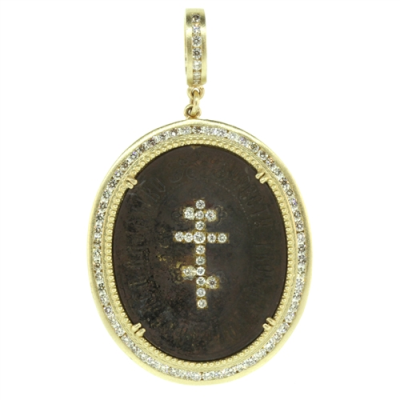 """Cynthia Ann is a Huston based designer and her collection """"Ancient & Old"""" consists of authentic vintage crosses & coins. She hand picks each piece and repurposes them into pendants. The original coins & crosses were made by hand, not machines, and were calling to be """"re-purposed"""" and """"re-loved"""". The history, brilliant craftsmanship and unique stones are what drew her to each precious piece. Each piece is lovingly and uniquely designed to enhance its original history and beauty making it one of a kind.Diamond weight 1.70ct, 14k Yellow Gold 14.3g, Sterling Silver."""