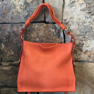 """LaNae's Amanda Over the Shoulder Handbag is made of genuine python skin. Proudly handcrafted in the USA by 3rd generation artisans, all edges are hand painted, interior is garment suede and is detailed with Italian palladium hardware. It comes with an over the shoulder strap extending to 20"""". The interior is complete with one zippered and two open pockets. The cell phone pocket on the outside of the handbag is super convenient! The strap drop is 10"""". Each luxury bag is one of a kind and especially made for you to stand out against the crowd!"""