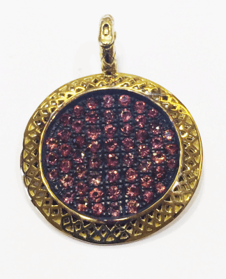 18k yellow gold crownwork framed round pendant with pave red sapphires (2.25cts).