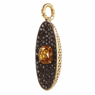 18k Yellow gold crownwork elocngated pendant with pave black diamonds and center stone burnt orange zircon. Zircon: 3.8cts BDIA: 6.2cts