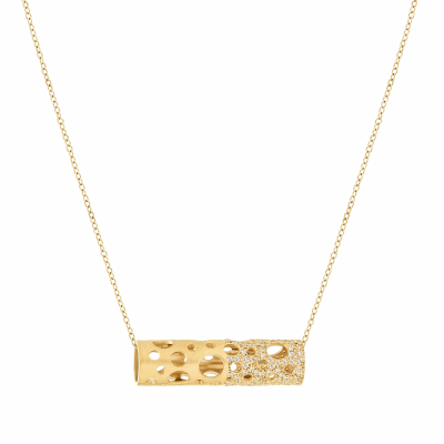 "A signature Dana Bronfman piece, the Holly Pendant is a tube-shaped piece featuring circular cutouts of varying sizes and diamond pavé. Its delicate chain can be slipped through any hole to wear horizontally, vertically, or slightly off-kilter.   Pendant available in 18 karat yellow or white gold. Features white or black diamond pavé embellishing half of the pendant approx. .9-1 tcw Adjustable (up to 18"") 18 karat yellow gold chain.  Matte finish. 3.4 wide x 9.8 long, 10g. Made in New York City from the world's finest materials and ethically-sourced diamonds. Please allow 3-4 weeks for delivery as each piece is created specially for you."