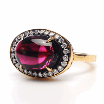 18k yellow gold classic oval claw set pink tourmaline with oxidized silver and pave surround. Pink Tourmaline: 4.8cts DIA:0.44cts