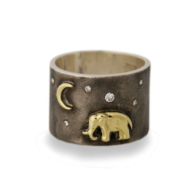 An 18K gold elephant stands majestic under the twinkling diamond sky.  The Silver Tsavo Nights Ring features an 18K gold elephant and moon set on a wide band of oxidized silver.