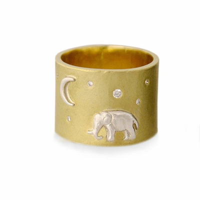 Set on a wide solid 18K gold band, a silver elephant stands majestic underneath a twinkling diamond sky.