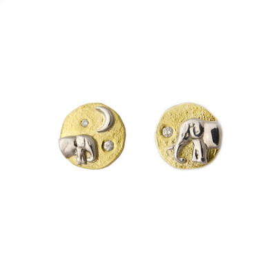 A mismatched pair of studs shows an emerging mama elephant on one earring and a baby elephant on the other.  Both elephants are silver and are featured under a sparkling constellation of white diamonds set on a platform of 18K gold. 1/2""