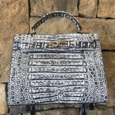 Proudly handcrafted in the USA by 3rd generation artisans, all edges are hand painted, interior is garment suede and is detailed with Italian palladium hardware. Each luxury bag is one of a kind and especially made for you to stand out against the crowd!