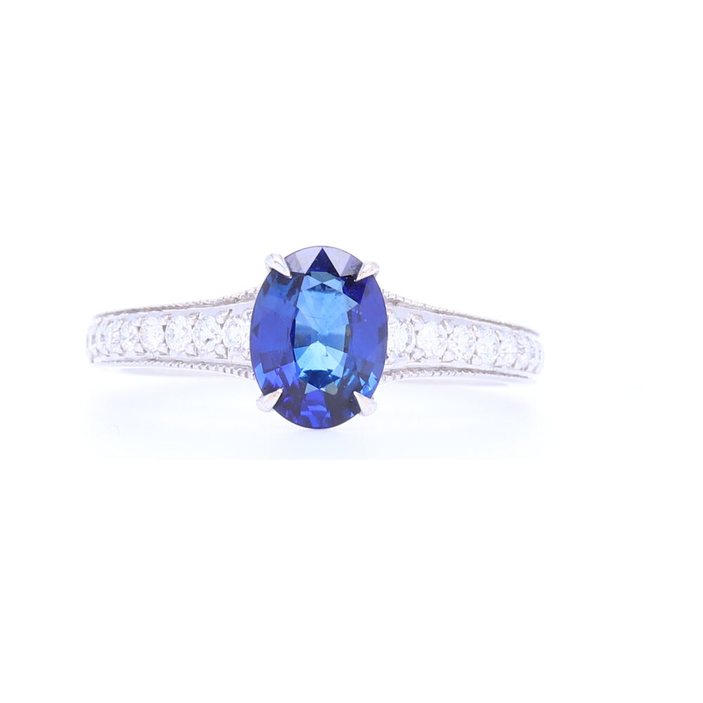 Vivid Blue Oval Sapphire Solitaire with Pave Diamond Shank