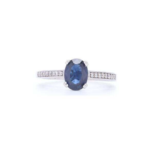 Closeup photo of Stunning Blue Oval Shaped Sapphire Ring with Diamonds 1/2 down the Shank