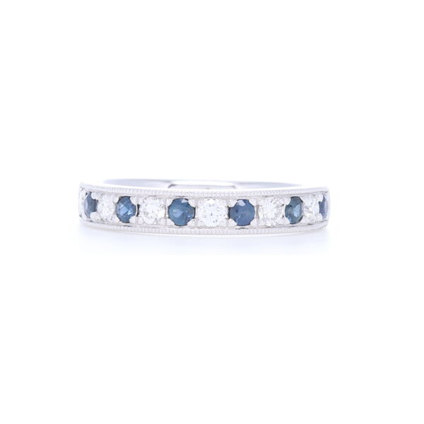 Closeup photo of Prong/Channel Round Diamond & Sapphire Ring in 14k White Gold