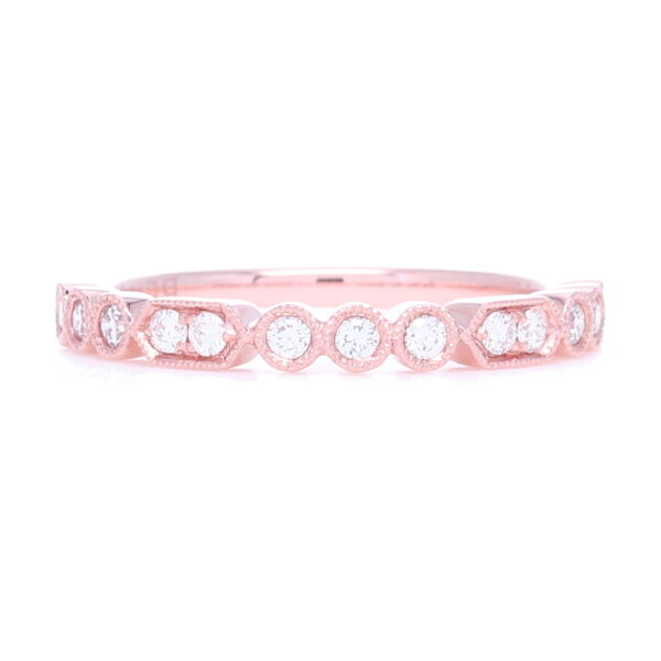 Closeup photo of Prong and Bezel Set Diamond Stack Ring set in 18k Rose Gold