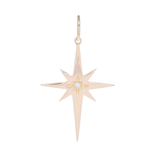 Closeup photo of Large Gold North Star Charm Pendant with a Diamond