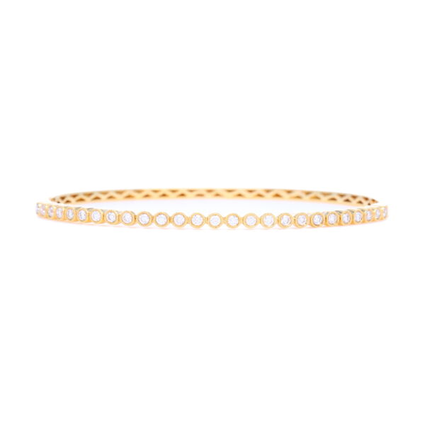 Closeup photo of 18k Yellow Gold Diamond Bezel Set Bangle