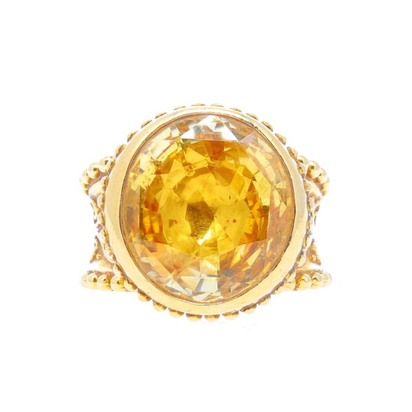 Closeup photo of 18K YG Cynthia Bach Oval Scroll work 18ct Yellow Sapphire