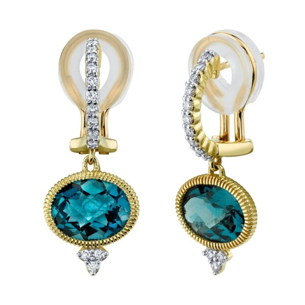 Closeup photo of Sideways Oval London Blue Earring With White Diamond Detail