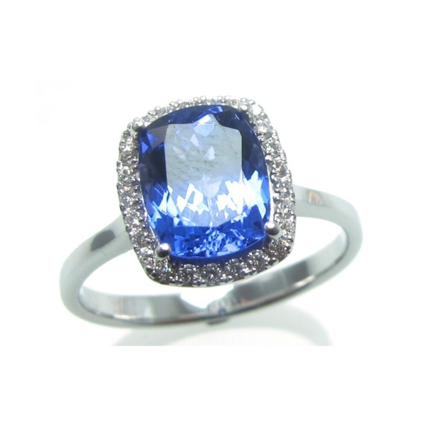 Closeup photo of 18k Tanzanite Ring with Diamond Halo