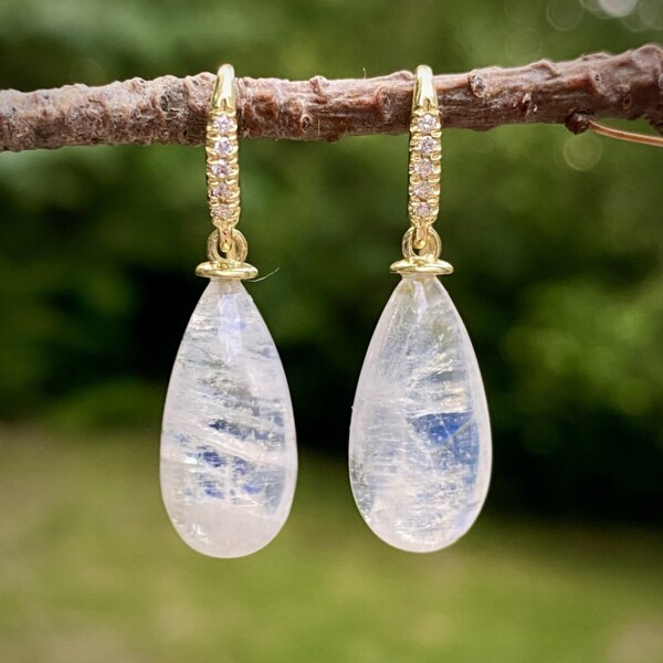 Closeup photo of Cabochon Rainbow Moonstone Biolette Earrings