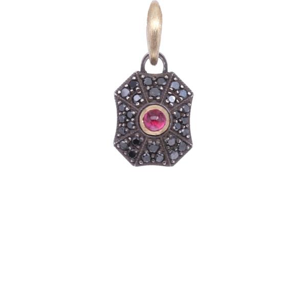 Closeup photo of 18k Black Diamond Shield with Ruby Center