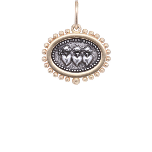 Closeup photo of 18k Triple Sacred Heart Oblong Charm Pendant